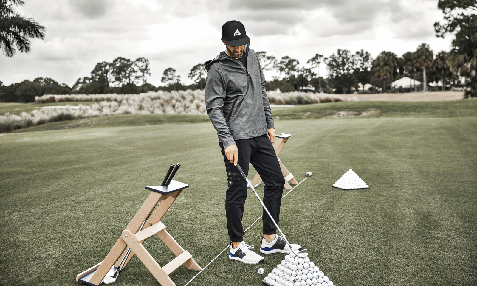 Dustin Johnson, practices in the new adicross urban-inspired golf collection