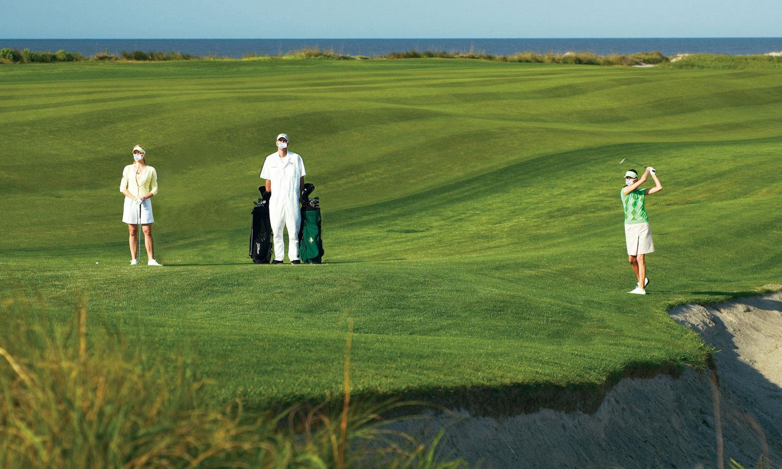 Golfers wearing masks