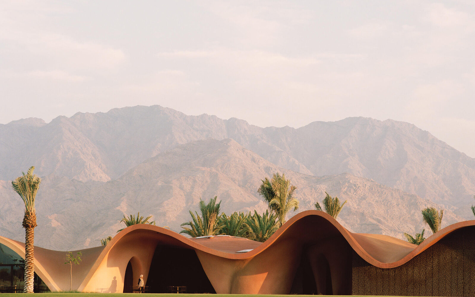 Ayla Golf Club Architecture inspired by sweeping red sand dunes